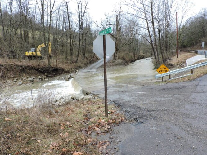 T-L Photo/JENNIFER COMPSTON-STROUGH High water from McMahon Creek covers Huddock Hill Road in Richland Township on Thursday. Local emergency officials remind residents not to drive through high water, as the consequences can be deadly.
