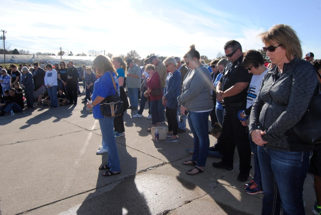 T-R PHOTO BY ADAM SODDERS Hundreds bowed their heads as Pastor Dylan Does led three prayers for the officers killed in the Des Moines area earlier this week and for law enforcement officers and emergency personnel, local and national.