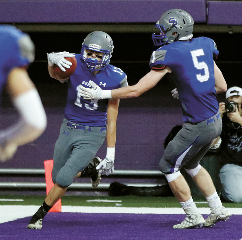 T-R PHOTO BY ADAM RING • Gladbrook-Reinbeck wide receiver Matt Johannsen (13) celebrates with Matt Roeding (5) after hauling in a touchdown catch in the fourth quarter of the Class A state title game against Bishop Garrigan Thursday at the UNI-Dome in Cedar Falls. The score was Johannsen's first of his career, and ended up being the game-winning TD in the 20-19 win.