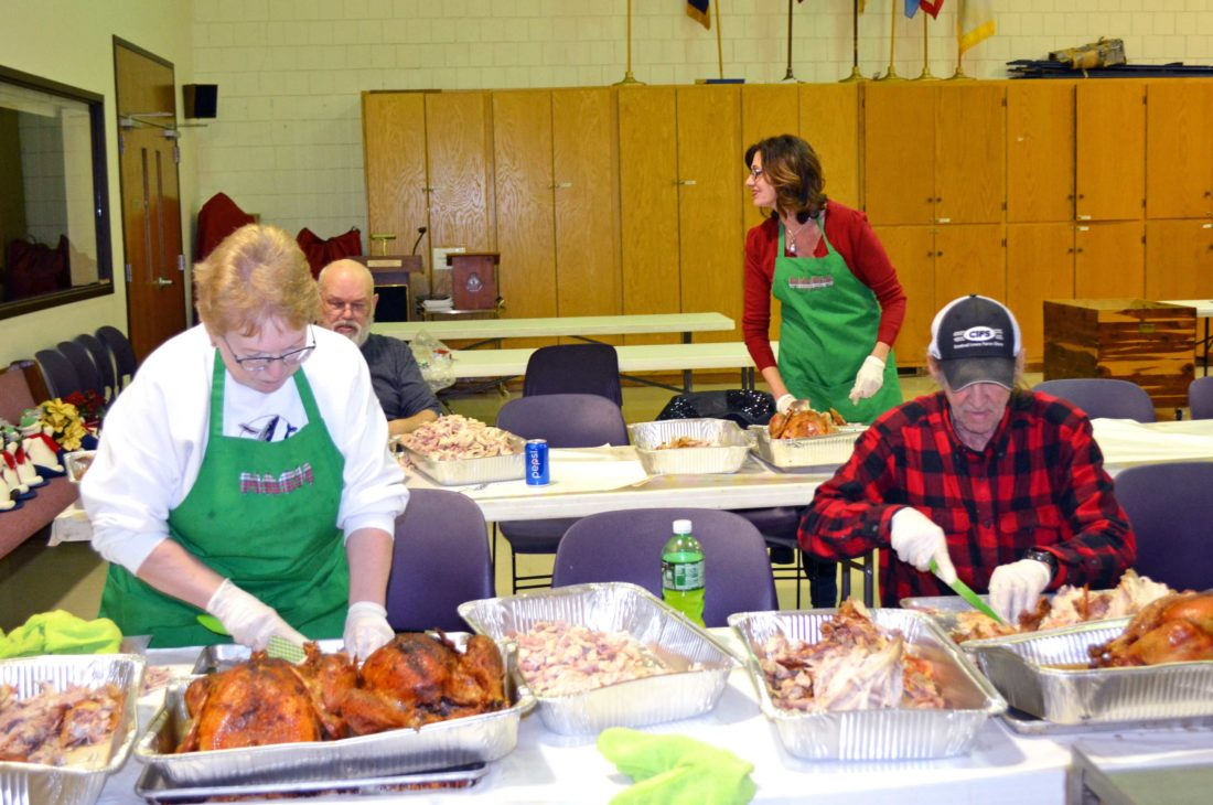 On Monday, volunteers began the process of preparing to feed over 700 people for the Salvation Army's annual free Thanksgiving meal, held this Thursday at the Salvation Army, located at 107 West State Street in Marshalltown. Dine-in and carry-out will run 11 a.m. to 2 p.m., with deliveries to Marshalltown residences available from 11 a.m. to 1 p.m. Monday afternoon, volunteers de-boned 47 turkeys — smoked and donated by Smokin' G's — and processed 150 pounds of potatoes. Marshalltown High School students will help make the dressing and bake 120 pumpkin pies. In addition, a sweet potato soufflé will be served, plus ham, corn, green beans, homemade mashed potatoes and gravy, dinner rolls, cranberry sauce and a bevy of desserts. To add your name to the meal delivery list, please call the Salvation Army by noon on Wednesday at 641-753-5236. Volunteers to help cook throughout the week and serve the meal and clean-up are always needed.