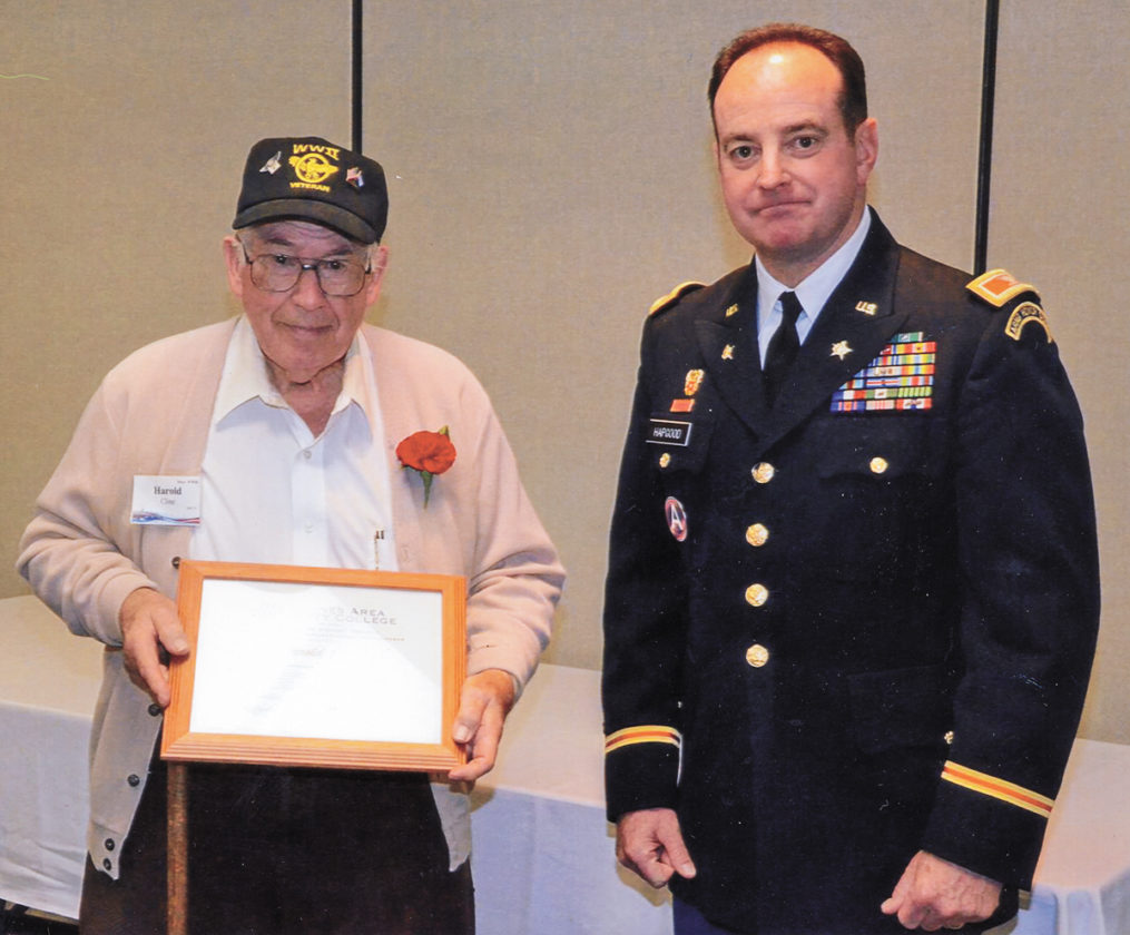 CONTRIBUTED PHOTO From this Nov. 6, 2015 photo, Harold Cline, left, of Marshalltown is shown with a plaque honoring participation in the Veterans History Project presented by Col. Gregory Hapgood, right. The award was made during ceremonies at the Des Moines Area Community College campus in Newton. In addition to Cline, 12 other Central Iowa veterans were honored.