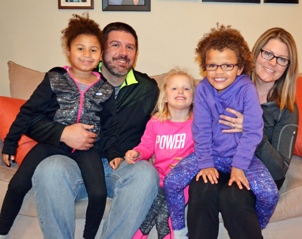 T-R PHOTO BY                 SARA JORDAN-HEINTZ  Sara and Justin  Nickel of Marshalltown  adopted three  siblings on Adoption Saturday, and they  are looking forward  to building a life with them.  The couple adopted twin girls Libby,  far left, and Mya,  far right, 4, and  their little sister  Allie, 3.