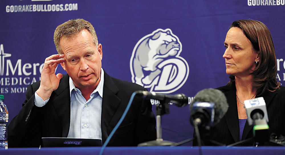 AP PHOTO • Drake University men's basketball coach Ray Giacoletti speaks during a news conference as athletic director Sandy Hatfield Clubb, right, looks on, Tuesday at the Knapp Center in Des Moines. Giacoletti resigned after three-plus seasons with the program.