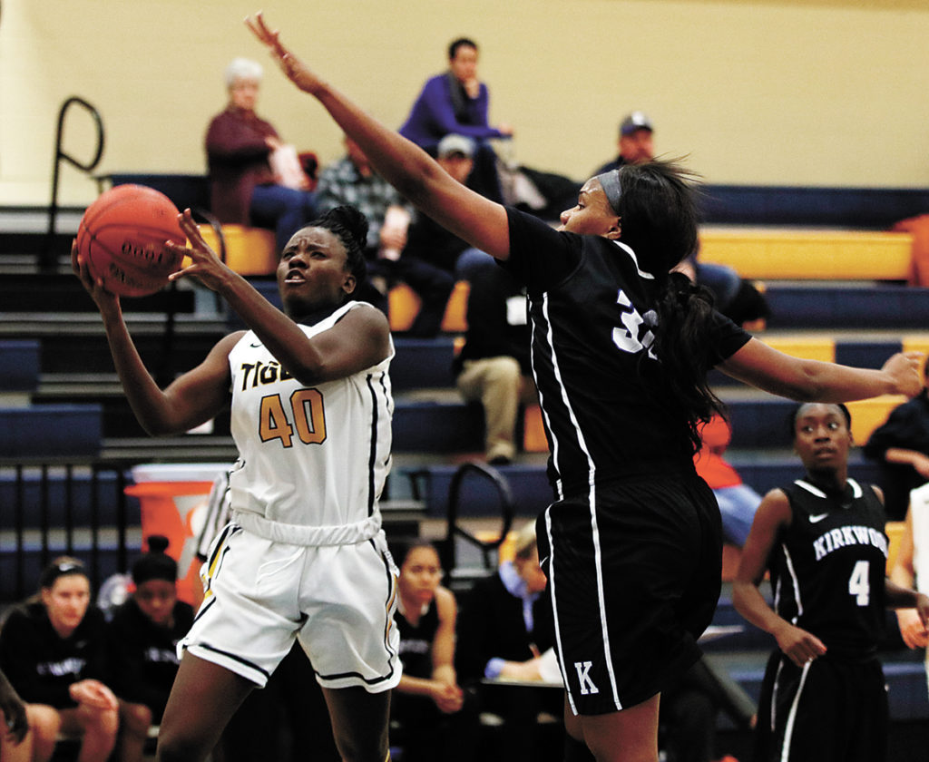 T-R PHOTO BY ADAM RING • Marshalltown Community College's Estelle Eduardo (40) drives to the hoop against Kirkwood Community College's Simone Goods, right, in the first quarter Wednesday at the Student Activity Center. MCC struggled to shoot the ball, and Kirkwood came away with the 77-41 win.