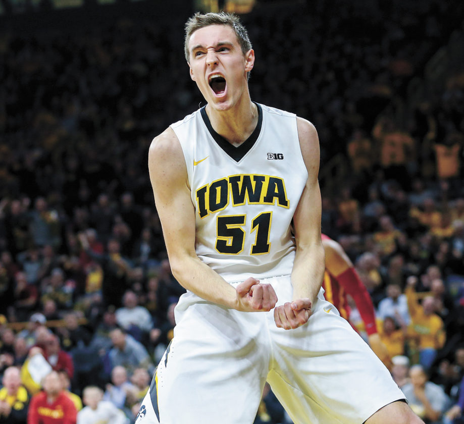 AP PHOTO • Iowa forward Nicholas Baer celebrates after making a basket and being fouled during the first half of a men's college basketball game against Iowa State on Thursday night in Iowa City. Baer had 10 points and a team-leading eight rebounds off the bench as the Hawkeyes won 78-64.