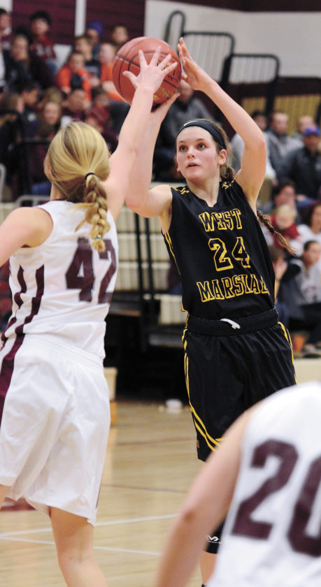 T-R PHOTO BY STEPHEN KOENIGSFELD • Isabelle Gradwell shoots off a screen against Grundy Center's Brooke Flater during the second half of Friday night's game in Grundy Center. Despite a slow start, Gradwell had a season-high 25 points in the 51-31 win.
