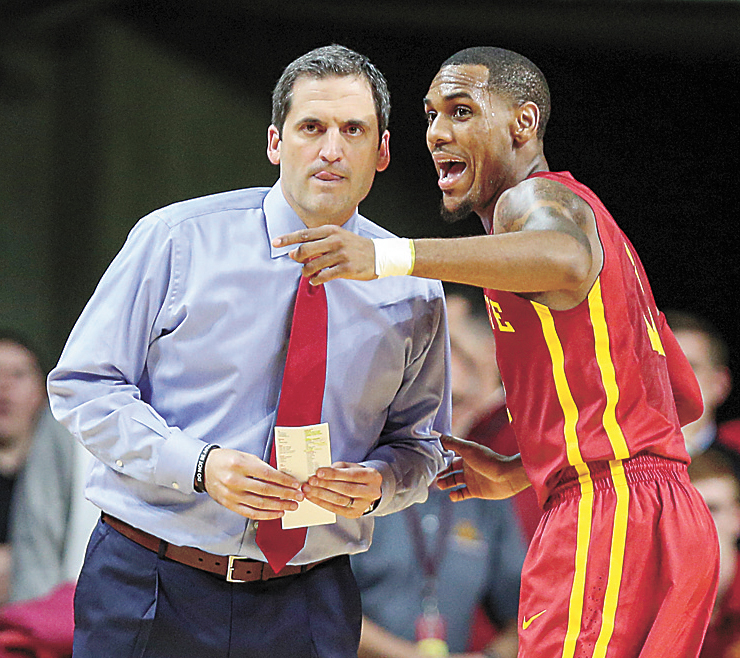 AP PHOTO • Iowa State head coach Steve Prohm and senior point guard Monté Morris talk during a break in play during the first half of a college basketball game against Cincinnati on Dec. 1 in Ames.