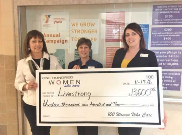 CONTRIBUTED PHOTO Gina Ruddock, left, from 100 Women Who Care presents a check in the amount of $13,600 to Carol Hibbs, CEO of the YMCA-YWCA, and Heidi Draisey for the Livestrong program at the YMCA.