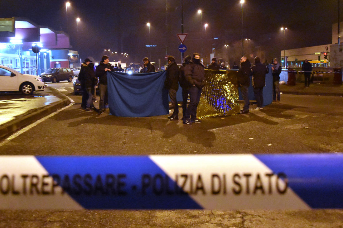 """AP PHOTO Italian Police cordon off an area after a shootout between police and a man near a train station in Milan's Sesto San Giovanni neighborhood, Italy, early Friday. Italy's interior minister Marco Minniti says the man killed in an early-hours shootout in Milan is """"without a shadow of doubt"""" the Berlin Christmas market attacker Anis Amri."""
