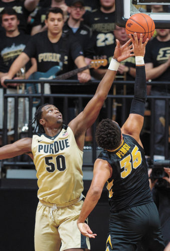 AP PHOTO • Purdue forward Caleb Swanigan (50) tries to block a shot attempt by Iowa forward Cordell Pemsl (35) in the first half of a Big Ten Conference men's basketball game on Wednesday night in West Lafayette, Ind.