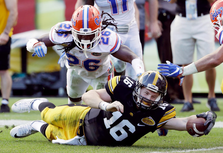 AP PHOTO • Iowa quarterback C.J. Beathard (16) stretches for the goal line in front of Florida defensive back Marcell Harris (26) during the first half of the Outback Bowl on Monday at Raymond James Stadium in Tampa, Fla. Beathard was stopped on the 1-yard line, and the Hawkeyes eventually lost 30-3.