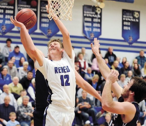 T-R PHOTO BY STEPHEN KOENIGSFELD • Gladbrook-Reinbeck's Caden Kickbush (12) drives in for a layup during the second half of Tuesday night's NICL West Division game in Reinbeck. Kickbush had 10 points in the 47-42 win against AGWSR.