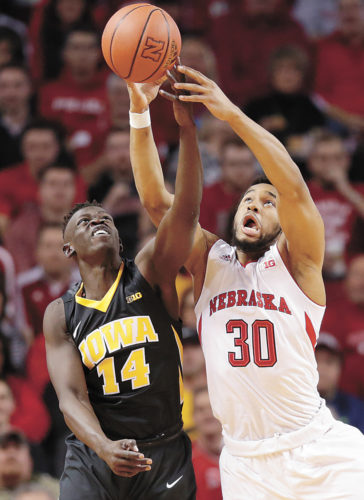 AP PHOTO • Iowa's Peter Jok (14) and Nebraska's Ed Morrow (30) compete for a rebound during the first half of a Big Ten Conference men's basketball game Thursday night in Lincoln, Neb.