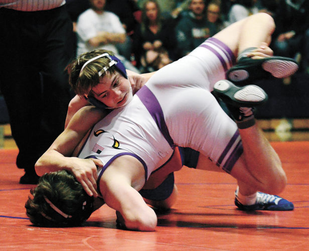 T-R PHOTO BY STEPHEN KOENIGSFELD • Marshalltown's Reese Hageman works to pin Johnston's Elliot Pohlmeyer on Thursday night. Hageman remained undefeated this year (16-0), but the Bobcats lost 59-18.