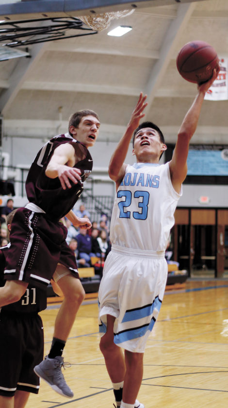 T-R PHOTO BY ADAM RING • South Tama County's Riley Davenport drives through the Independence defense for a layup in the second quarter of the WaMaC West contest Friday night in Tama. Davenport had 13 points for the Trojans, helping STC to a 61-38 win.