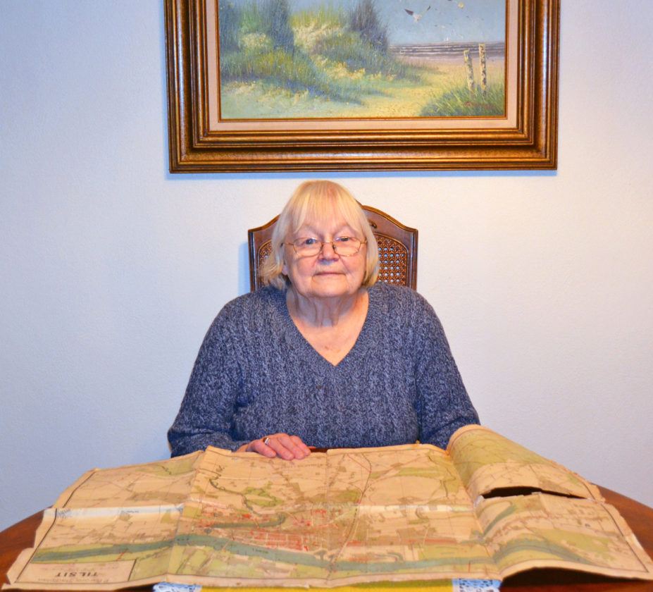 T-R PHOTO BY SARA JORDAN-HEINTZ Gertrud Schakat Tammen, 85, evacuated East Prussia in the mid-1940s at 13 years old, as a refugee bound for western Germany. Here she sits with a map of her hometown of Tilsit, East Prussia, which is today part of Russia. Bombing by Soviet forces was so prevalent before the evacuation, that as a child, Tammen used a red crayon to mark every spot on the map where a bomb had dropped on the city. She has lived in Marshalltown since 1954.