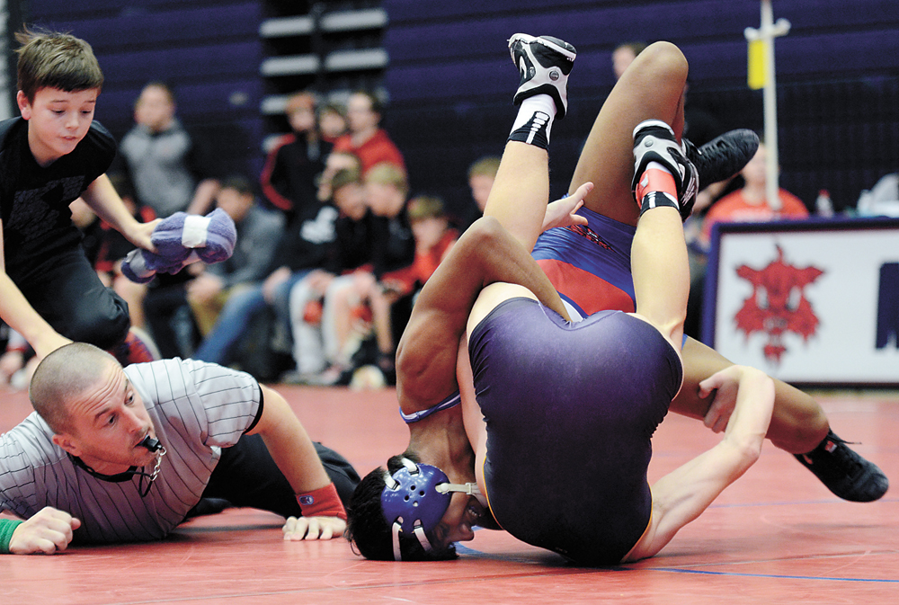 T-R PHOTO BY ROSS THEDE • Marshalltown senior 138-pounder Carlos Gomez starts the Bobcats' final dual against Webster City with a pin of Cade Felts during the Allie Morrison Duals on Saturday at the Roundhouse. Gomez got two pins on the day and the Bobcats won a pair of duals in finishing sixth in their own tournament.