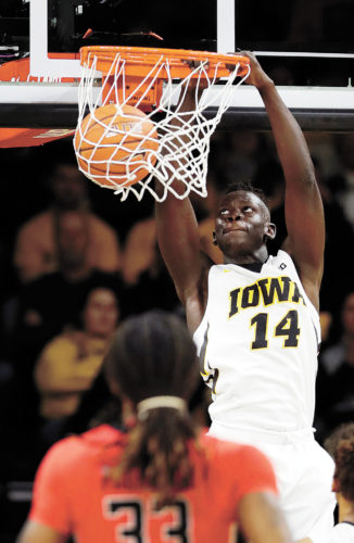 AP PHOTO • Iowa guard Peter Jok dunks during the second half of an NCAA college basketball game against Rutgers, Sunday, Jan. 8, 2017, in Iowa City.