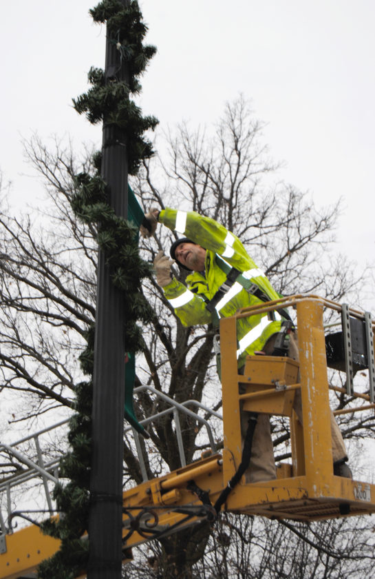 City employees were hard at work on Main Street Monday morning taking down holiday decorations like wreaths, banners and lights that have lit up downtown Marshalltown the last several weeks.