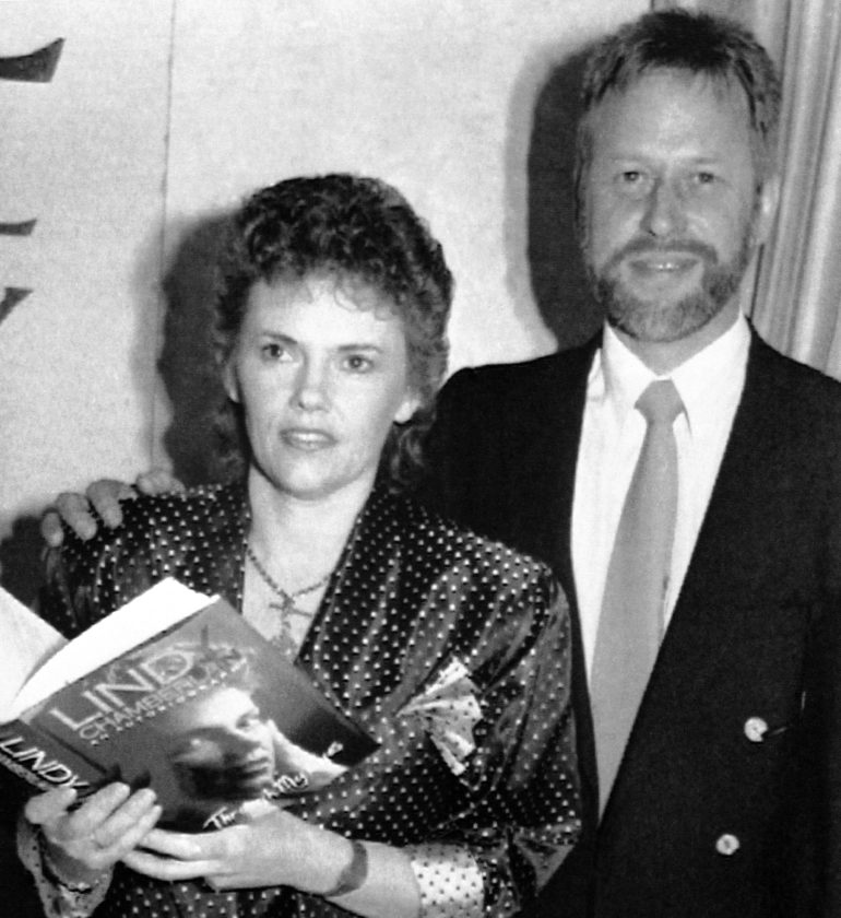 FILE - This October 1990, file photo shows Michael Chamberlain, right, and then his wife Lindy when Lindy launched her book on the disappearance of her baby daughter Azaria in 1980. Chamberlain, who waged a long battle to prove his baby daughter was killed by a dingo in Australia's most notorious case of injustice, has died, Chamberlain's ex-wife Lindy confirmed Tuesday,  Jan. 10, 2017. He was 72. (AP Photo/Russell McPhadran, File)