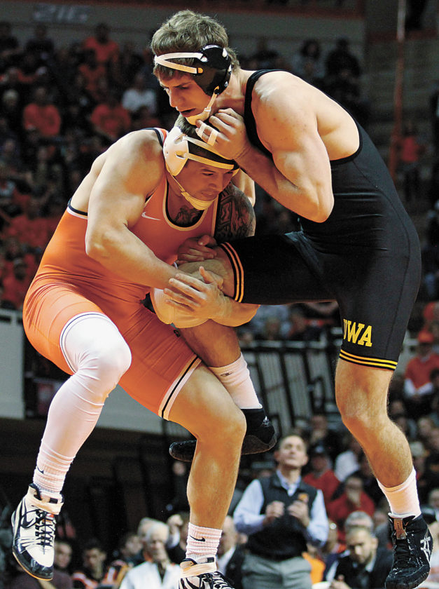 AP PHOTO • Oklahoma State's Kyle Crutchmer, left, and Alex Meyer wrestle during Saturday's college wrestling match in Stillwater, Okla. The top-ranked Cowboys beat the Hawkeyes 24-11.