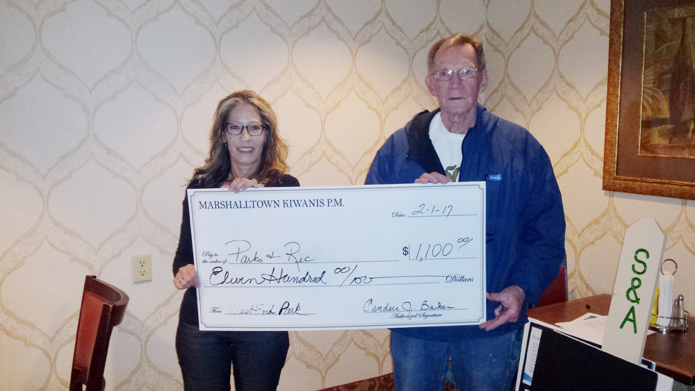 CONTRIBUTED PHOTO Kiwanis P.M. President Kenny Lamb presented its annual check to Parks and Recreation Director Anne Selness for the West End Park for building or repairs.