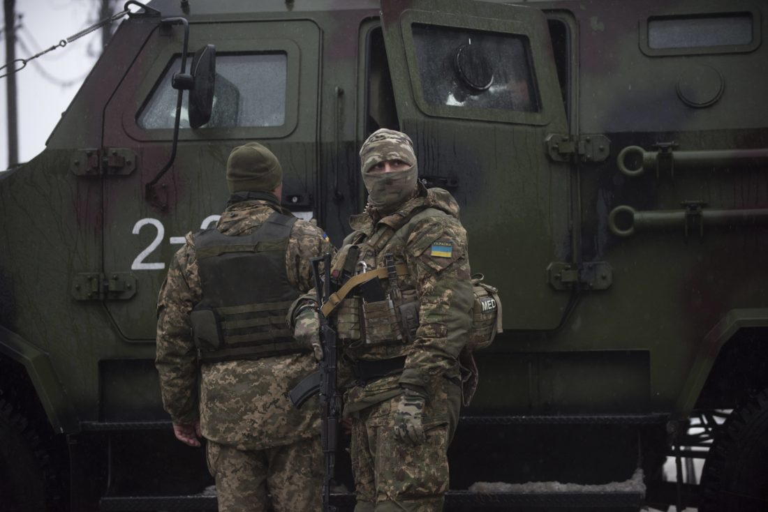 AP PHOTO Ukrainian servicemen patrol near the humanitarian aid center in Avdiivka, Ukraine, Saturday.