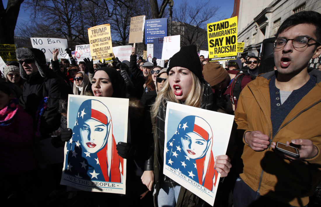 AP PHOTO People chant during a rally protesting the immigration policies of President Donald Trump, near the White House in Washington, Saturday.