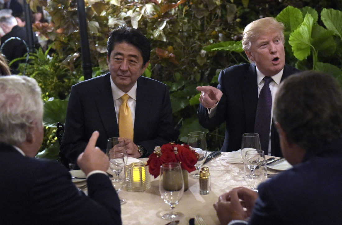AP PHOTO President Donald Trump, second from right, sits down to dinner with Japanese Prime Minister Shinzo Abe, second from left, at Mar-a-Lago in Palm Beach, Fla., Friday. Robert Kraft, owner of the New England Patriots, is at left. Trump is hosting Abe and his wife for the weekend.
