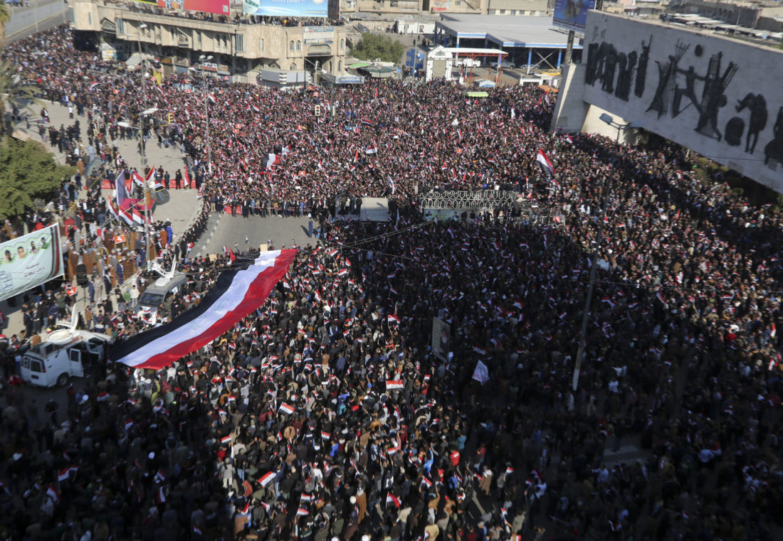 AP PHOTO Followers of Iraq's influential Shiite cleric Muqtada al-Sadr chant slogans as they wave national flags during a demonstration against corruption in Baghdad, Iraq, Saturday.