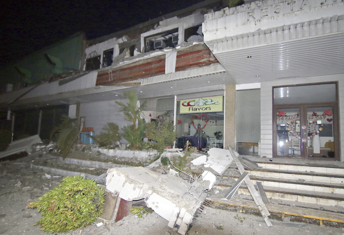 AP PHOTO Fallen debris from a business establishment are seen following a powerful nighttime earthquake that rocked Surigao city, Surigao del Norte province Saturday, in southern Philippines.