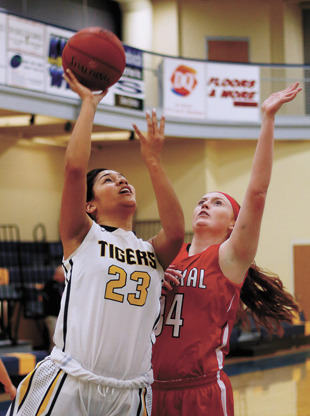 T-R PHOTO BY ADAM RING • Marshalltown Community College's Loralei Siliga (23) puts up a shot against Emily Salvador (34) of Central JV on Monday at the Student Activity Center. Siliga scored 10 points, including eight in the second half, in MCC's 70-58 win.