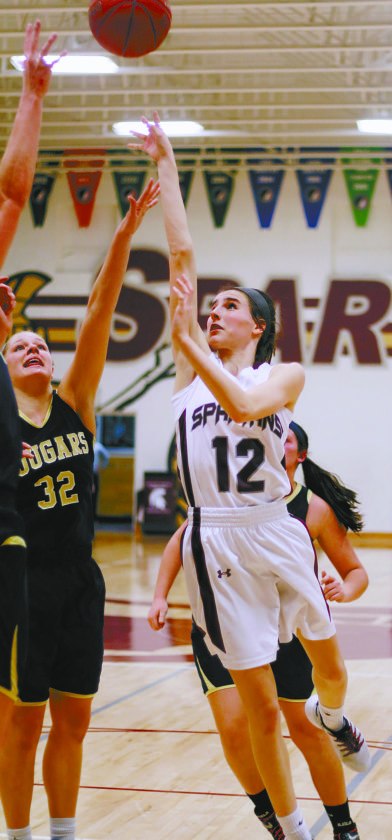 T-R PHTOO BY ADAM RING Grundy Center's Hailey Wallis (12) shoots a floater against Sumner-Fredericksburg's Jenna Brandt (32) in Tuesday's Class 2A Region 5 quarterfinal in Grundy Center.