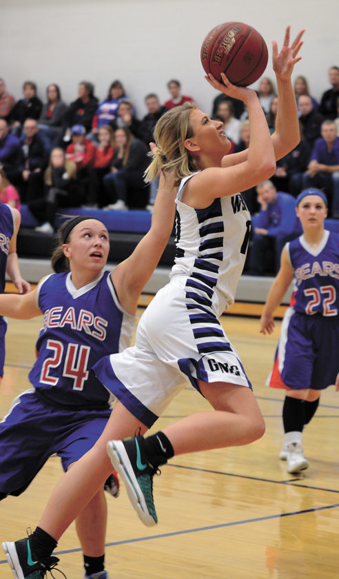 t-r photo by ross thed GMG senior Blaire Sonderleiter gets past BGM defender Lizzy Worthington (24) for two of her game-high 17 points during Tuesday's Class 1A regional girls' basketball quarterfinal in Garwin.