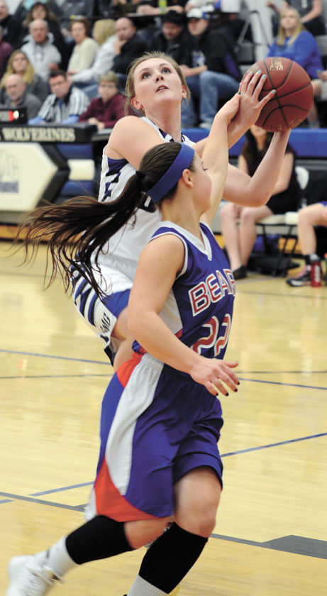t-r photo by  GMG's Kelsey Vaverka has the ball knocked away by BGM's Hope Beck (22) during the first quarter of Tuesday's Class 1A Region 7 quarterfinal in Garwin. The Wolverines beat the Bears, 44-40.