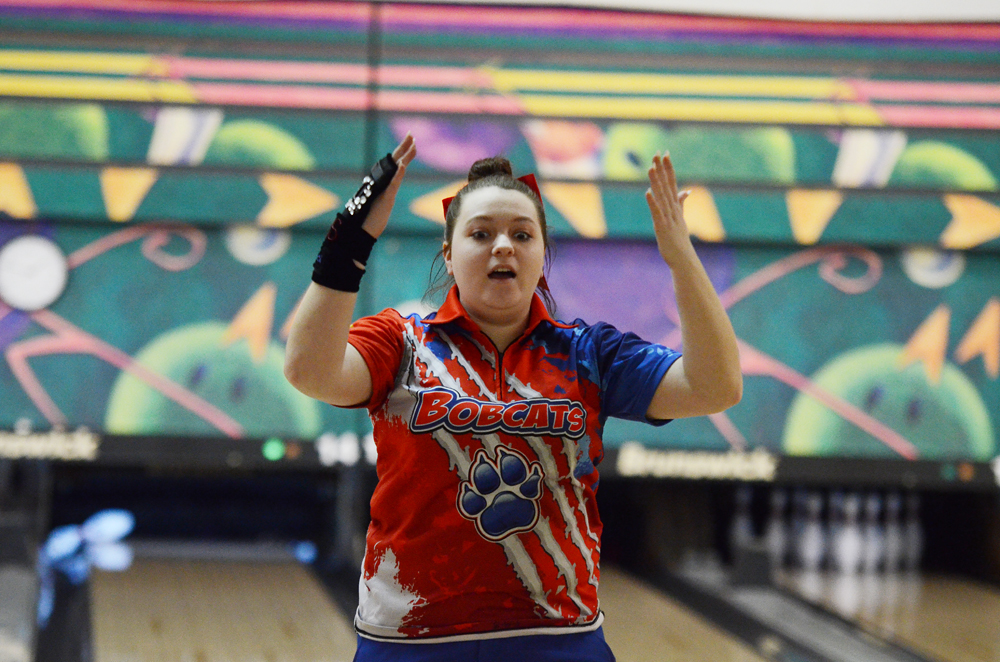 t-r photo by stephen koenigsfeld Ali Olinger reacts in relief to a strike finally falling her way during an individual round at Tuesday's Class 3A District 6 meet. Olinger had a 320 series as the Bobcats finished third.