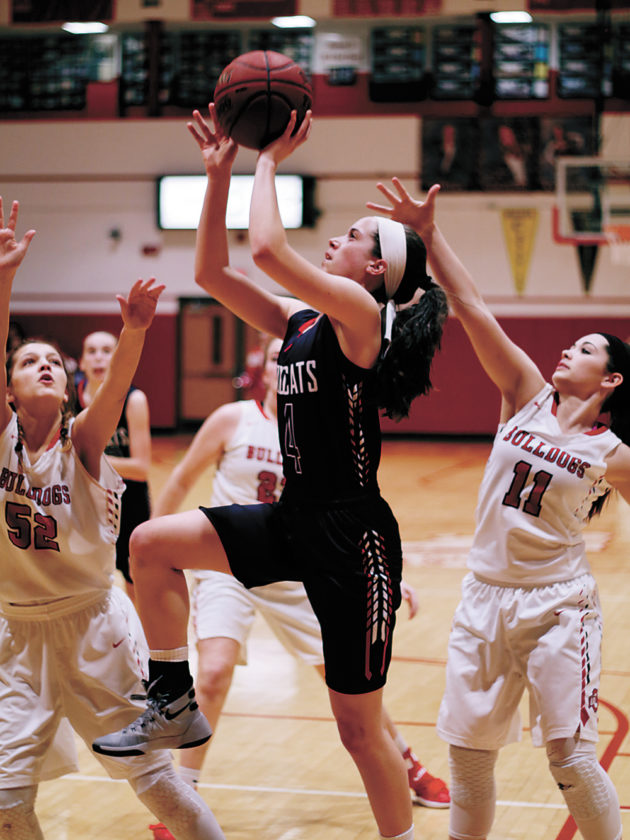 T-R PHOTO BY ADAM RING • Marshalltown's Erica Johnson (4) puts up a shot in the middle of the Ottumwa defense in the fourth quarter of Wednesday's Class 5A Region 4 opener in Ottumwa. The Bulldogs won 62-19.