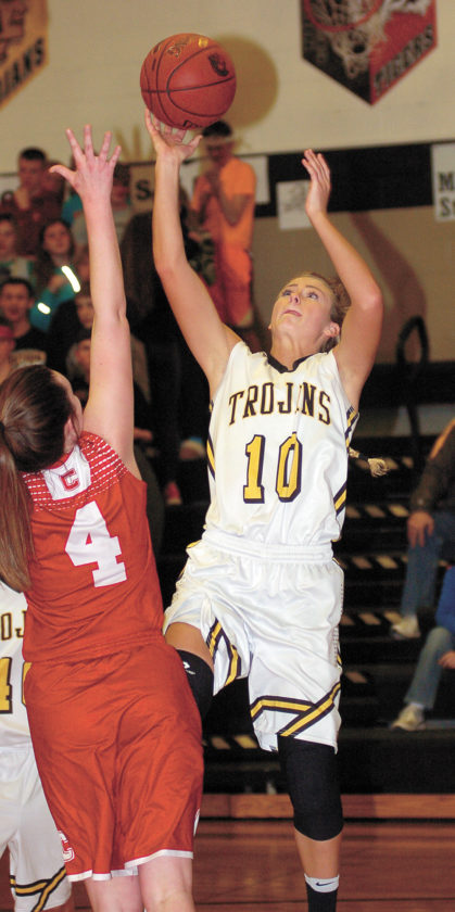 T-R PHOTO BY ROSS THEDE • West Marshall junior Brooke Snider (10) shoots and scores over Chariton defender Aubrie Richards (4) during the second half of Wednesday's Class 3A Region 8 semifinal. Snider finished with 11 points.