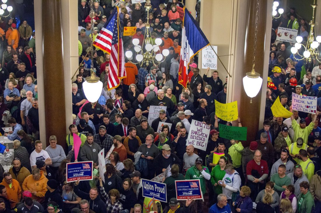 AP PHOTO The Iowa Capitol's first floor rotunda is filled with supporters and protesters before a hearing Monday, on collective bargaining changes in Des Moines.