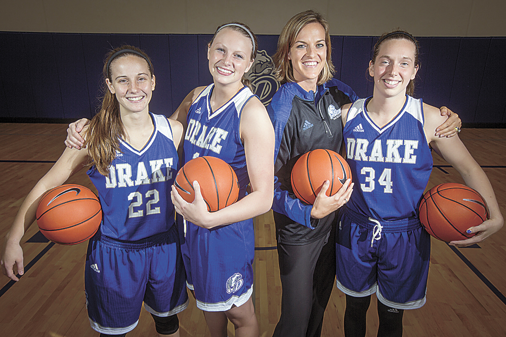 AP FILE PHOTO • From left: Caitlin Ingle, Lizzy Wendell, head coach Jennie Baranczyk and Cortni Rush pose for a portrait during Drake's women's basketball media day on Oct. 20, 2016, in Des Moines. Drake became perhaps the unlikeliest team to enter the AP Top 25 this season when it sneaked in at No. 25 on Monday.