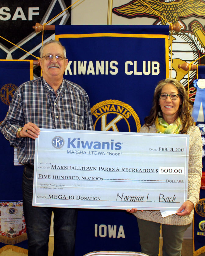 "CONTRIBUTED PHOTO Kiwanis ""Noon"" member Mike Gowdy presented a check to Park and Rec Director Anne Selness for the MEGA-10 Park upgrades."