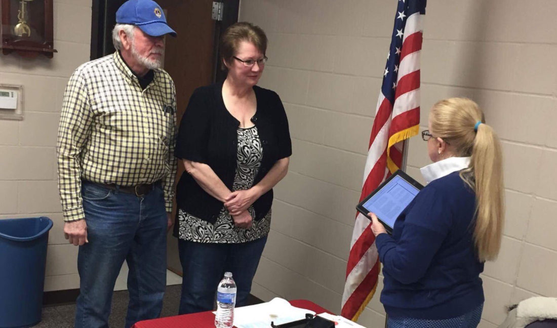 CONTRIBUTED PHOTO Nancy Meyer Davis, center, sponsored by Don Anderson is installed at the Marshalltown Evening Lions meeting by DGE Judy Stone.
