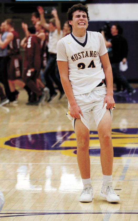 T-R PHOTO BY ADAM RING • East Marshall's Tyler DeBondt fights back the emotions following the Class 2A Substate 6 final against South Hamilton Saturday in Nevada. South Hamilton won in the final seconds, 53-51, to advance to the state tournament.