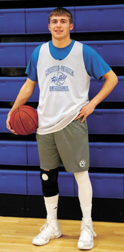 T-R PHOTO BY ADAM RING • Gladbrook-Reinbeck's 6-foot-5 senior forward Tyler Pierce poses for a photograph during Wednesday's practice in preparation for the upcoming Iowa High School Boys' State Basketball Tournament in Des Moines.