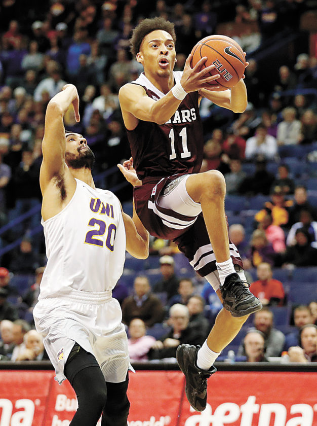 AP PHOTO • Missouri State's Jarred Dixon (11) heads to the basket past Northern Iowa's Jeremy Morgan during the second half of a men's basketball game in the quarterfinals of the Missouri Valley Conference tournament Friday in St. Louis. Missouri State won 70-64.