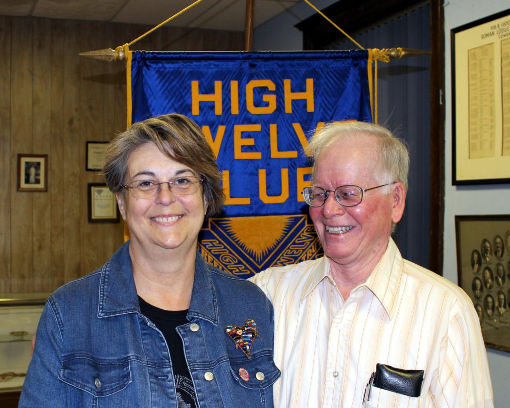 CONTRIBUTED PHOTO High Twelve Club's March program chairman Ron Benge introduces Beth Campbell who talked about her trip to Ghana and South Africa as a member of the 2016 Woman-to-Woman Worldwide journey sponsored by the International Disciples Women's Ministries.