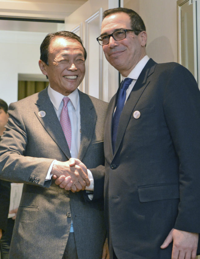 AP PHOTO Japanese Finance Minister Taro Aso, left, and U.S. Treasury Secretary Steven Mnuchin meet for talks ahead of the G-20 Finance Ministers meeting in Baden-Baden, southern Germany, Friday.