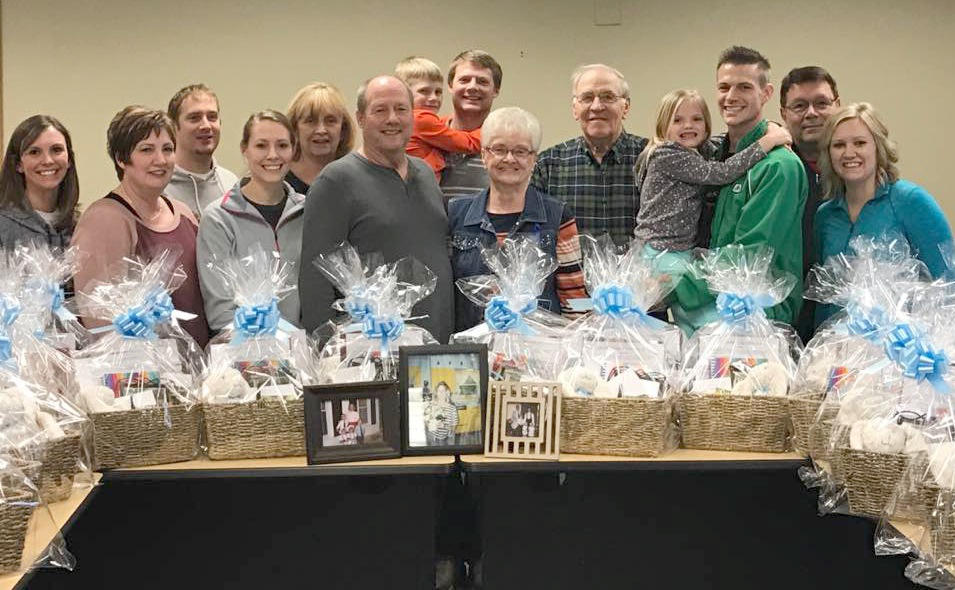 """CONTRIBUTED PHOTO The Hauser family with some of the """"Becky Baskets"""" they have put together for families/survivors of homicide."""