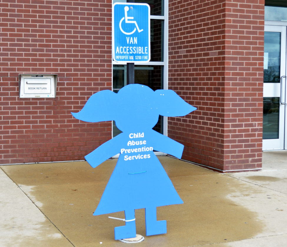 "T-R PHOTO BY SARA JORDAN-HEINTZ In recognition of April being Child Abuse Prevention Month, CAPS has placed ""Blue Kids"" around town, as a symbol of childhood. Pictured is a ""Blue Kid"" outside the Marshalltown Public Library. CAPS is offering a selfie contest, whereby people are asked to take selfie photos, posing with one of the ""Blue Kids,"" then uploading the images to CAPS's Facebook page, using the hashtag #CAPSbluekids. Each week in April, there will be a drawing awarding one lucky selfie contestant a $10 gift card to a local restaurant. CAPS will hold a celebratory rally at the Marshall County Courthouse lawn (inside the rotunda if there is inclement weather), on Friday, April 28, from 12:15-12:45 p.m."
