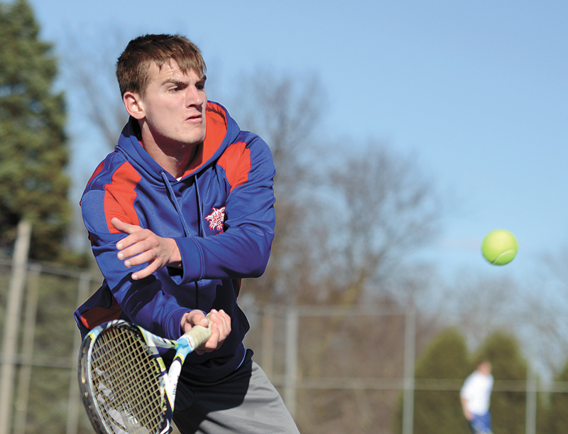 T-R PHOTO BY STEPHEN KOENIGSFELD • Marshalltown's Sam Brintnall returns a volley back at Fort Dodge's Chris Hatton on Thursday during their singles match at Marshalltown High School. Brintnall went on to win 6-1, 8-6 in his singles. The Bobcats won the meet 7-4.